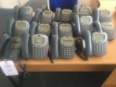 Fourteen Avaya 5402D01A digital IP telephone handsets