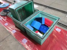 Three plastic boxes with tote bins