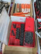 Drill bits in two tote bins