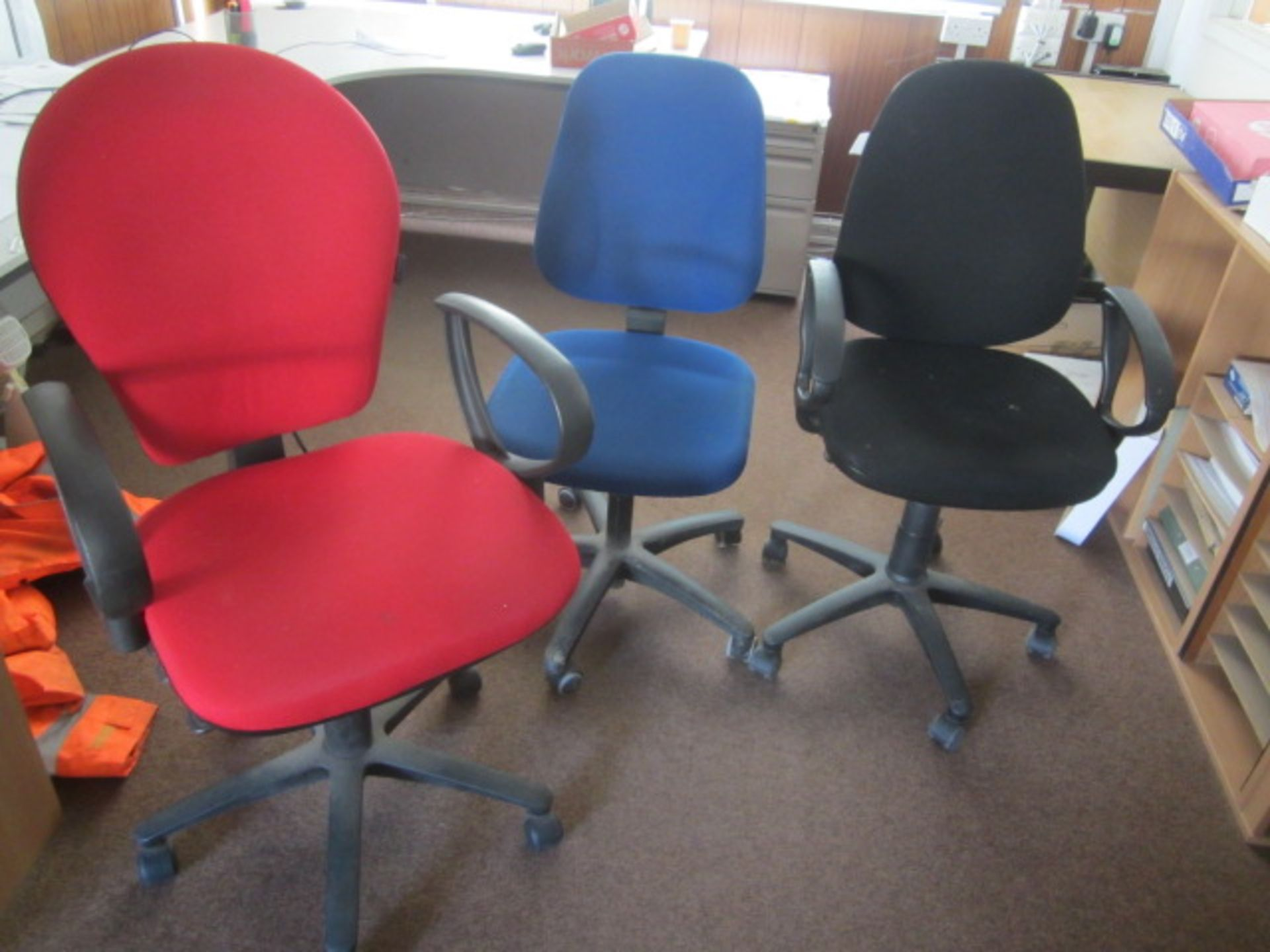 Three assorted cloth upholstered swivel office chairs