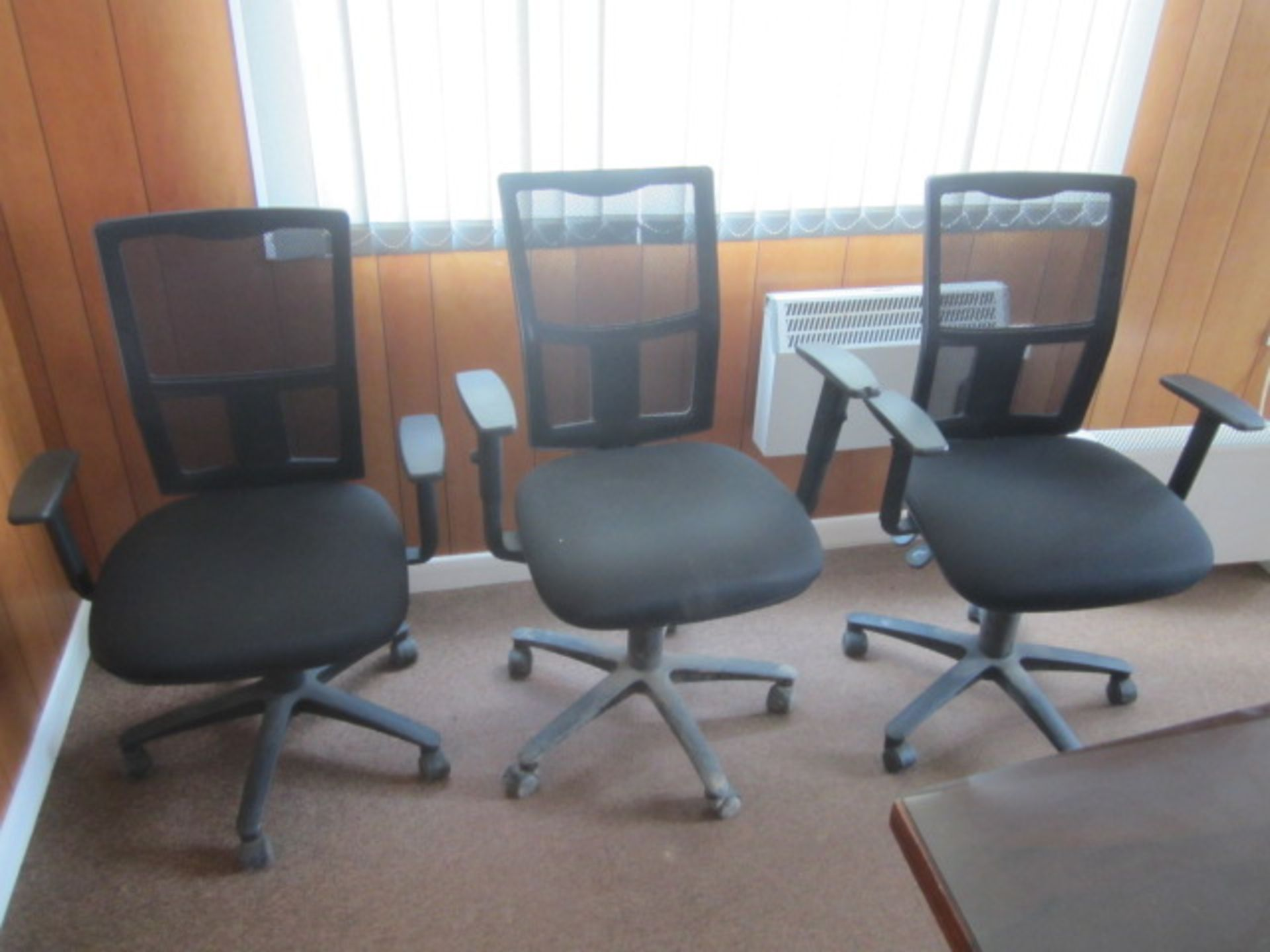 Three assorted cloth upholstered swivel office chairs, with mesh back