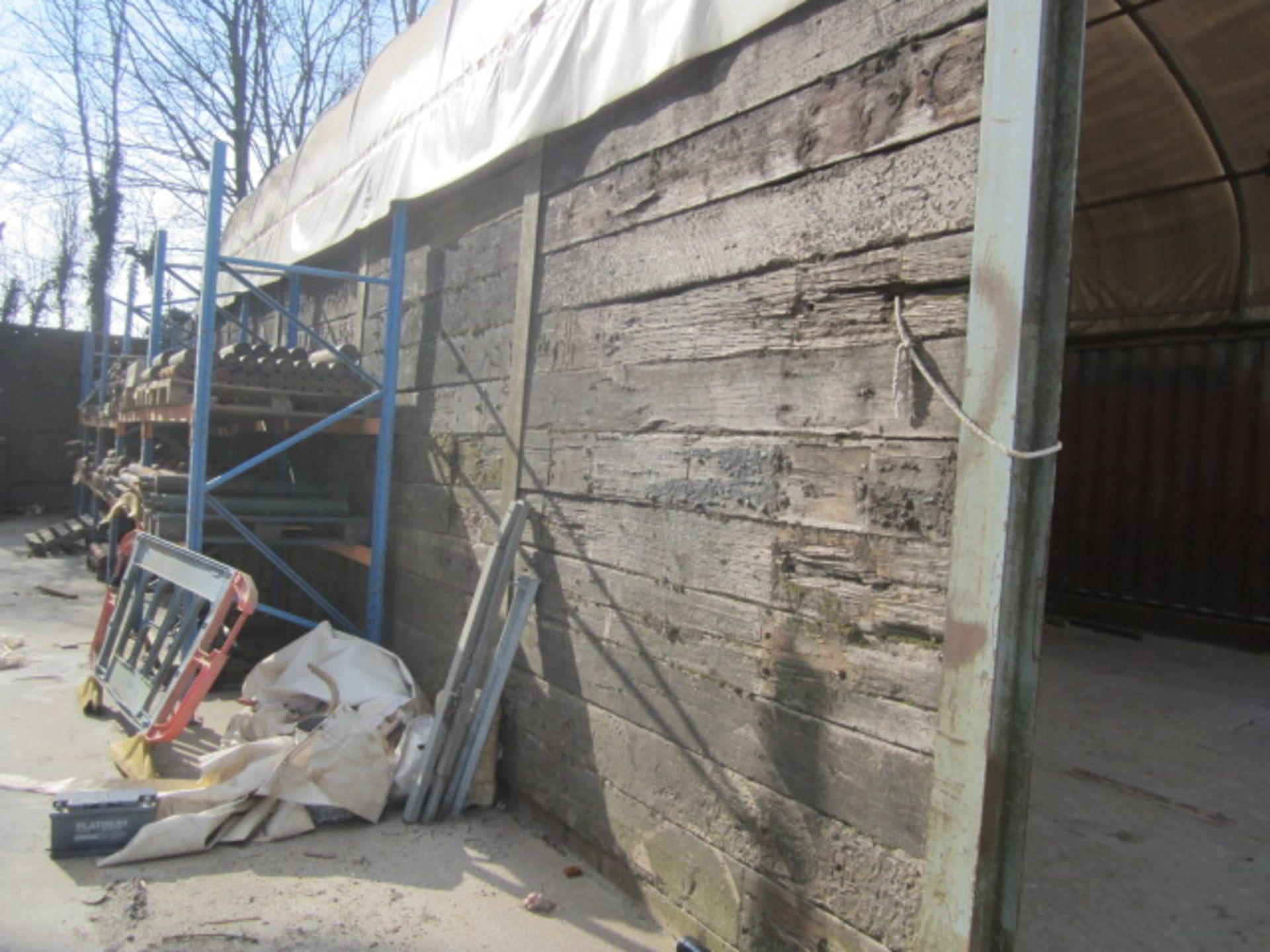 Approx. 80 railway sleepers mounted into wall section. A work Method Statement and Risk Assessment - Image 2 of 3