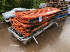 Eleven plastic chapter 8 fencing barriers and 3 steel fencing barriers