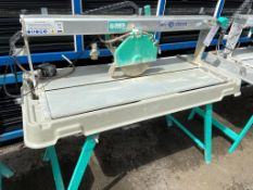 Imer combi 250 1000VA wet tile cutting machine 110V on a mobile foldaway stand and sink. s/n