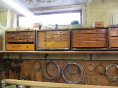 Contents of three shelves to include 7 mini wooden tool chests, spares, mobile trolley, sockets,