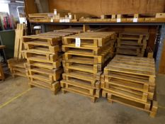 Approximately eighty-five wood pallets