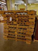 Twenty double wood pallets