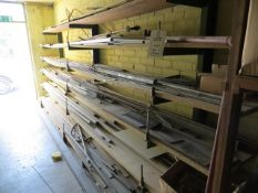Cantilever rack and contents of steel stock to include angle, rod, tube & flat steel as lotted