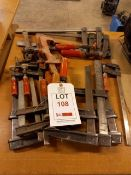 Ten various size screw clamps and two Carver and one unbranded rack clamps