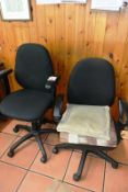 Two cloth upholstered swivel office armchairs