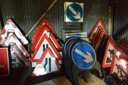 Large quantity of various road signs, located in rear of 'Arc' building