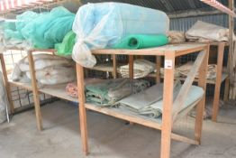 Contents of two timber racks, to include netting, water barriers, plastic, etc.