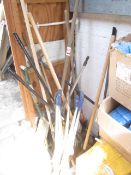 Assorted tools including rakes, pick axes, brushes, bolt cutters, etc.