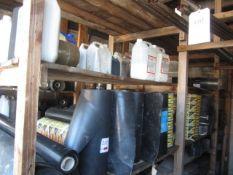 Three shelves of assorted damp proof course, fast set latex liquid, felt adhesive etc.
