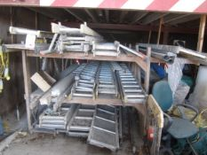 Thirteen assorted scaffold board panels and nineteen assorted ladders