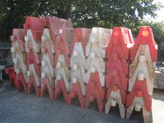 Forty three plastic orange & white barrier blocks, approx. 1000mm width