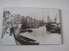 Four black & white photos on wood