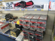 Contents of two display racks to include Fiamma & Milenco level up kits, gripper plates etc...