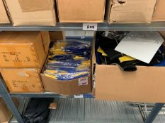 Shelf containing various wet suits & rash tops as lotted