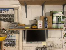 Contents of shelf including various jubilee clips, pins, and boxes of liquid grease and synthetic