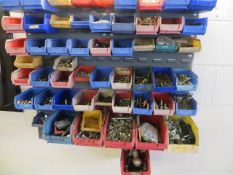Rack of various nuts and bolts as lotted
