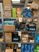 Contents of 4 shelves to include large quantity of Kampa power drill adaptors, carry bags & inner