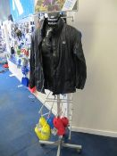 Six various Mac in a Sac rain covers/jackets c/w mobile half mannequin display stand