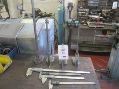Eight assorted measurement gauges, four height gauges and four vernier gauges