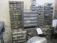 Nine assorted mini storage compartments and assorted miscellaneous stock and one wall mounted