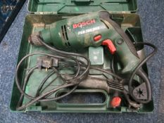 Bosch PSB 700 RES corded drill c/w case and a 16A-4H Multi Outlet Socket* This lot is located at