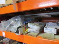 Three shelves of various nuts, washers, spill kits, angle iron, plates, threaded bar, brackets,