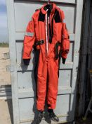 A storage box containing various sizes - 13x Ursuit Transit Suits, 3x Mullion Survival Technology