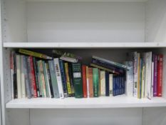 Shelf of books, including a photographic atlas of England
