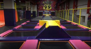 Modular trampoline park, comprising Basket ball jump zone, 2 netted jump pads, 2No 4m x 2m pads with