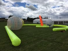 Land zorbs with inflatable track, thought to be 3