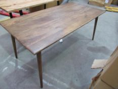 A Dark Wooden Dining Table
