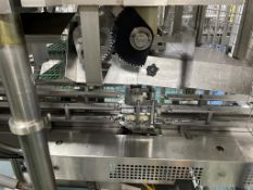 Hema Twin Head Can Filler. Overhead Acrylic Slat Belt Infeed Conveyor with Can Chute. Overhead Acryl
