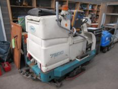 A Tennant 7200 ride on scrubber dryer