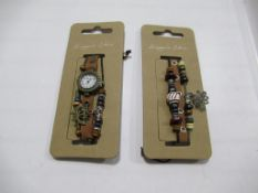 A box of Hippie Chic 'Boho' watches and bracelets