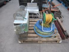 Pallet of animal traps/cages and hose pipes.