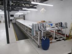 A 2017 Serkon Makina MN1 Master Continuous Cloth Spreader with 9-Section Cutting Table