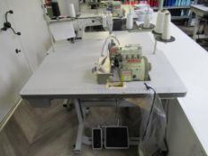 A Yamato CZ6120- Y6DF Needle 4 Thread Overlock Industrial Sewing Machine Complete with Table