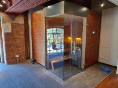 KLAFS Ventano Sauna, comprising American walnut exterior cladding, Hemlock veneer interior walls and