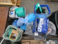 Pallet of PPE including hard hats, coveralls, sweatshirts, gloves etc