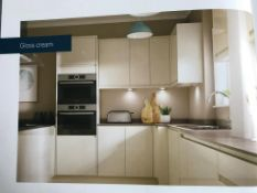 Cream gloss handle less kitchen doors and facias,