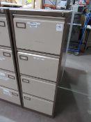 Two four drawer filing cabinates (no keys)