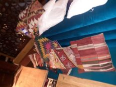 8 Arabic Carpet Cushions, Located at 14 Leicester Square, London WC2H 7NG