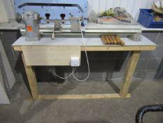 Unbranded wood turning lathe on wooden frame