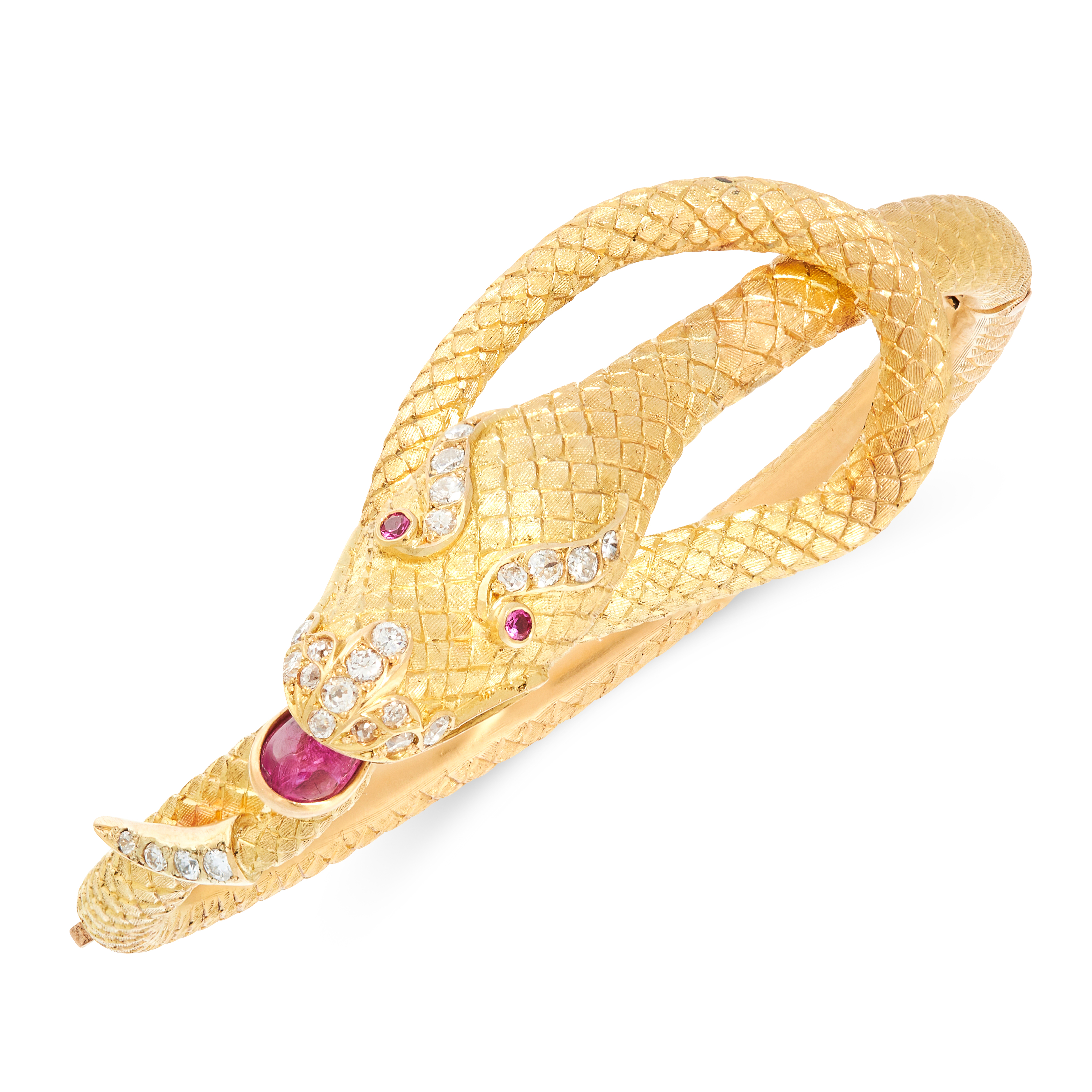 A RUBY AND DIAMOND SNAKE BANGLE in high carat yellow gold, designed as the body of a snake, coiled