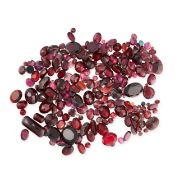 A MIXED LOT OF UNMOUNTED GARNETS various cuts and sizes, totalling 166.43 carats.
